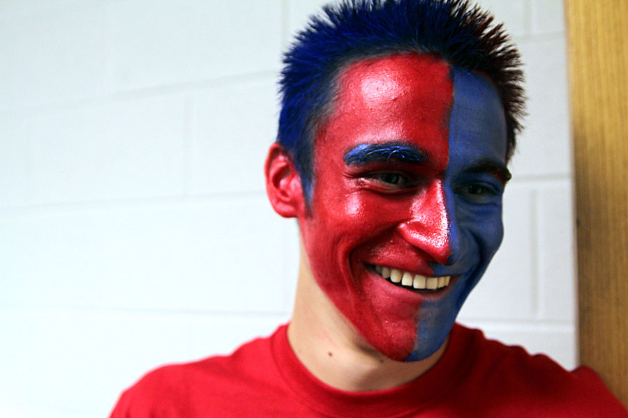 Senior Sagane Snow shows his spirit by painting his face and hair on Oct. 11 for spirit day.