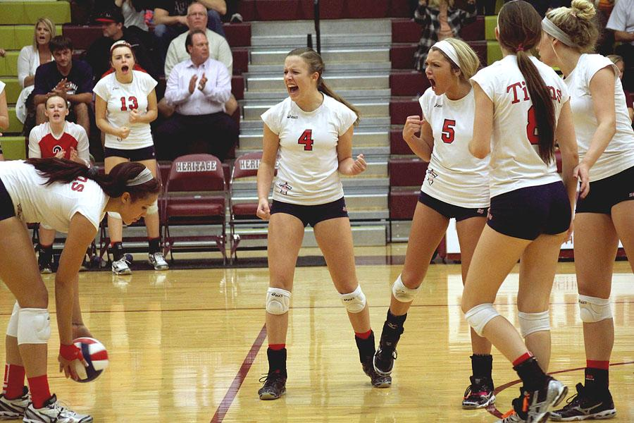Juniors Ashley Rauch and Brettley Burney celebrate a point on Oct. 22 during the volleyball game against Heritage HS.