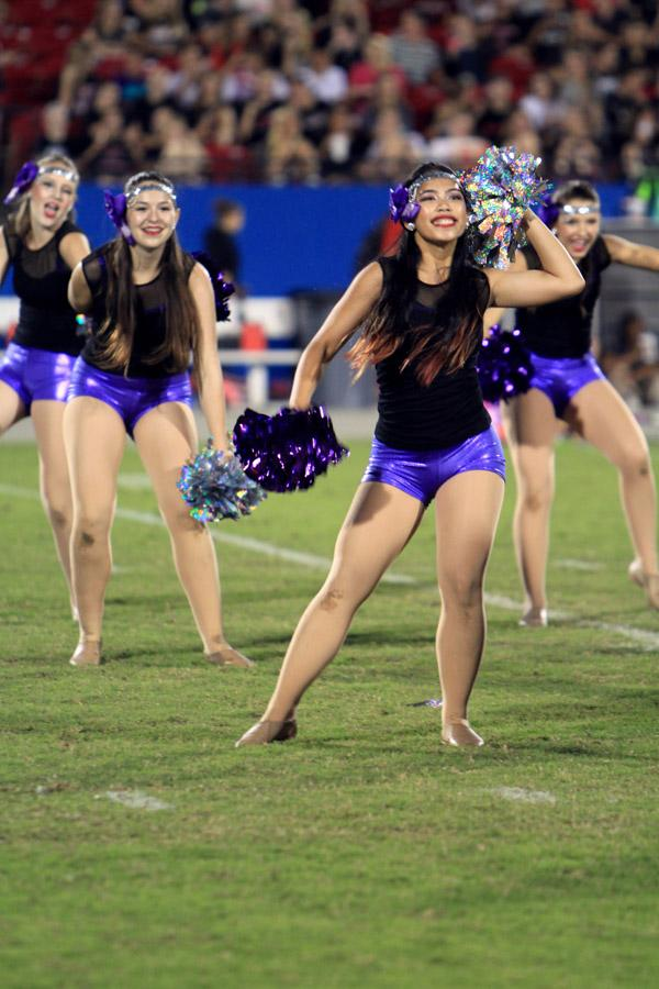 Senior Doris Penaga shows off her dancing skills on Oct. 11 during the game against Liberty HS.