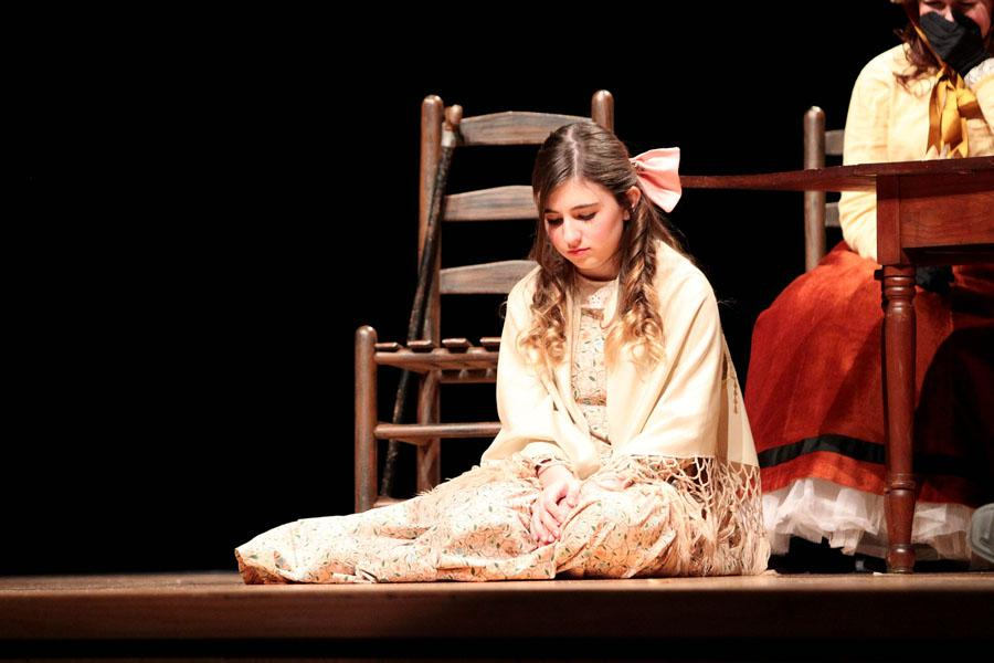 "Freshman Madeline Frost, who plays Belinda, weeps at the loss of her brother during the Dec. 11 performance of ""A Christmas Carol""."