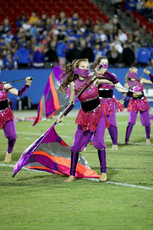 Freshman Holly Burkholder positions herself to twirl her flag on Oct. 25 during halftime against Frisco HS.