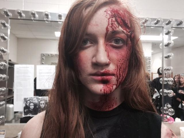 Carly Suhr displays an incredible make up job created by the Centennial theater tech students.