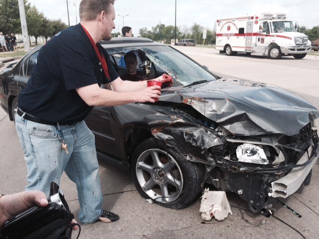 Ryan Burke, theater tech teacher puts the finishing touches on the crash vehicles.