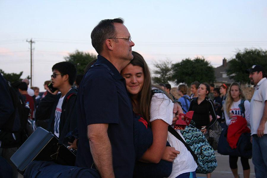 Kendall Bowser with her dad after returning from San Antonio. (Photo By Emma Bittner)
