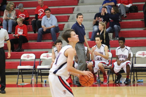 Coach Wilson watching Preston attempt a free throw against Mesquite Poteet.