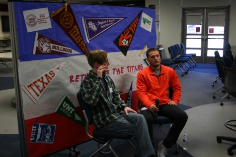Benjamin Braudrick and Nick Baril sit down while being interviewd