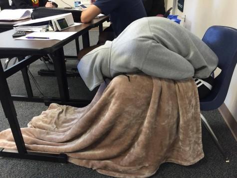 This smart senior brought his blanket to Economics.