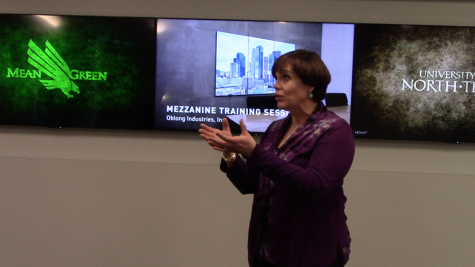 Administrator Brenda Sims explaining explains the technology available at the new UNT branch in Frisco.