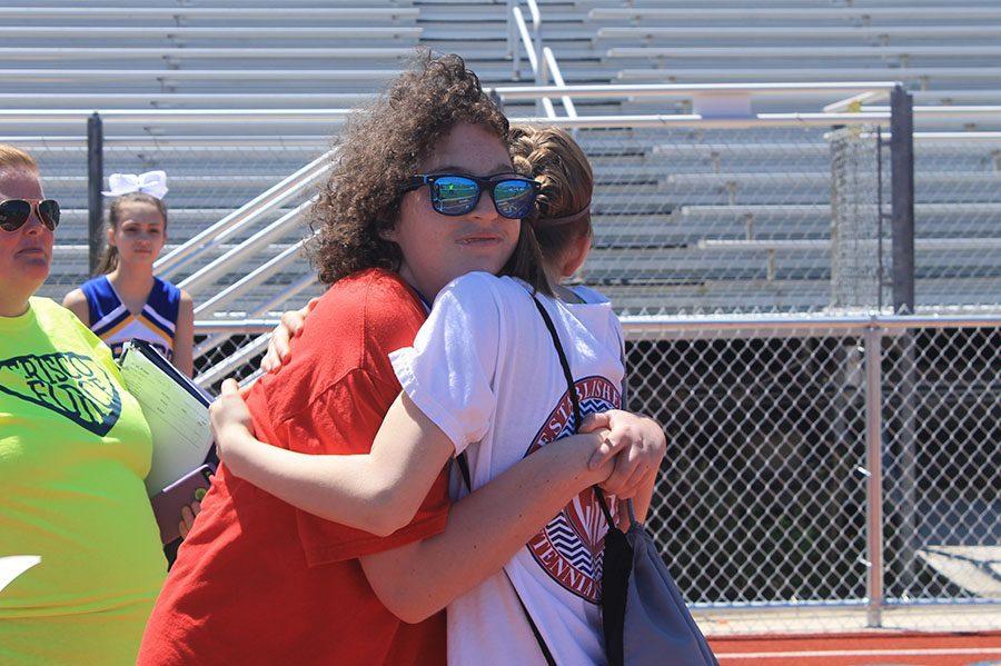 Centennial student hugs her partner after race (Photo by: Emma Bittner)