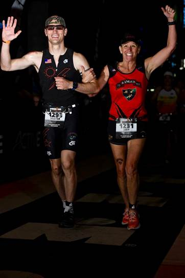 Judy Coon and her running mate crossing the finish line at a race. Used with permission of Sua Sponte Elite Racing Team.