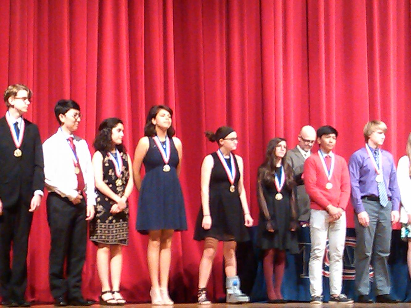 Students honored on stage at the awards ceremony.