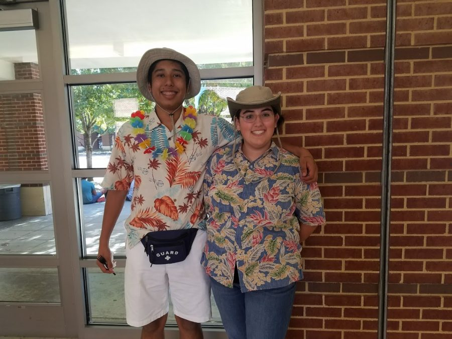 Marc Veloz (left) and  Emily McAnally (right) show off their outfits outside the courtyard.
