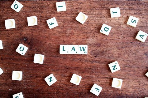 "Scrabble image of the word ""law""               Source: CQF- Avocat, pexels.com"